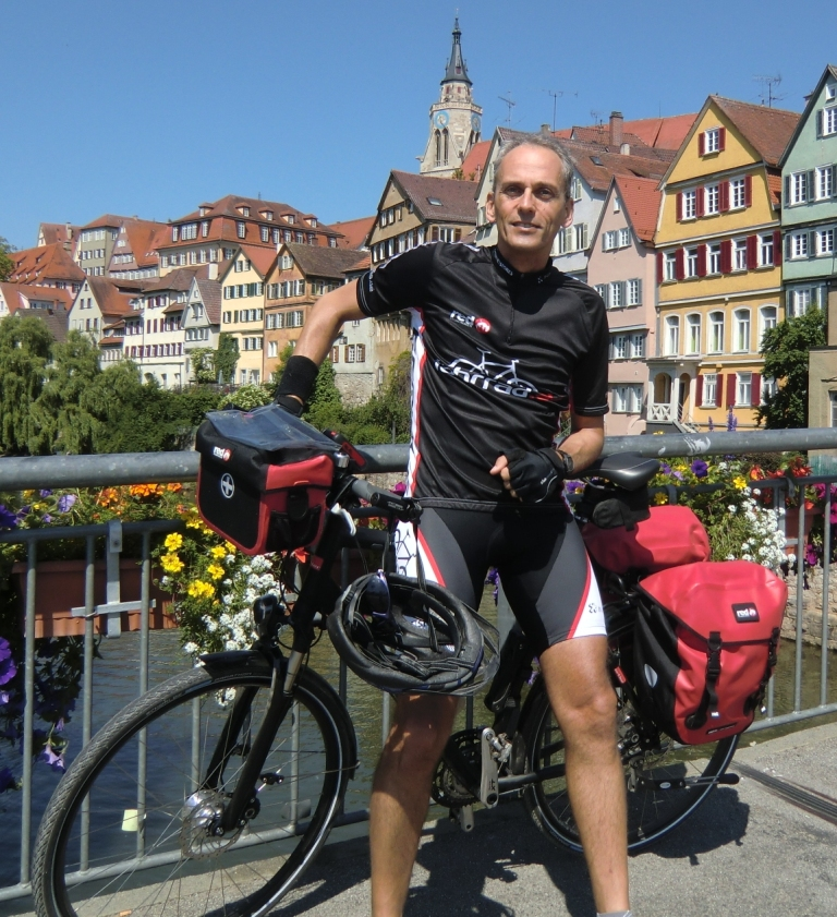 Mann auf einem Fahrrad. Foto: © Herrmann